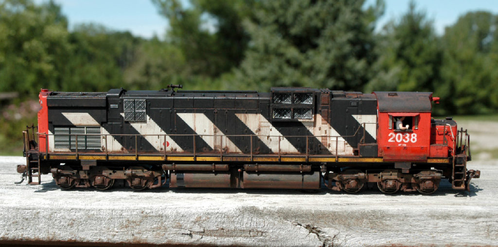 CANADIAN NATIONAL (CN) M630 #2038 model train that has been professionally built, painted and weathered by Tom Cox of Red Pine Precision Modeling.